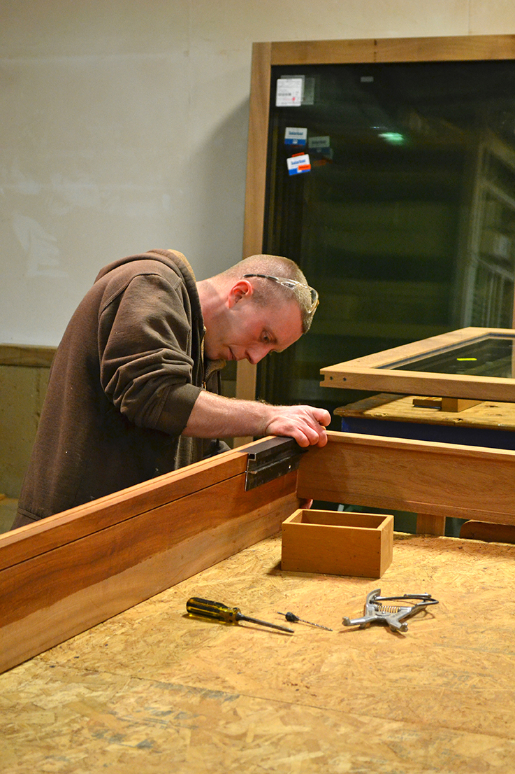 Craftsman Jon building a mahogany sliding glass door.